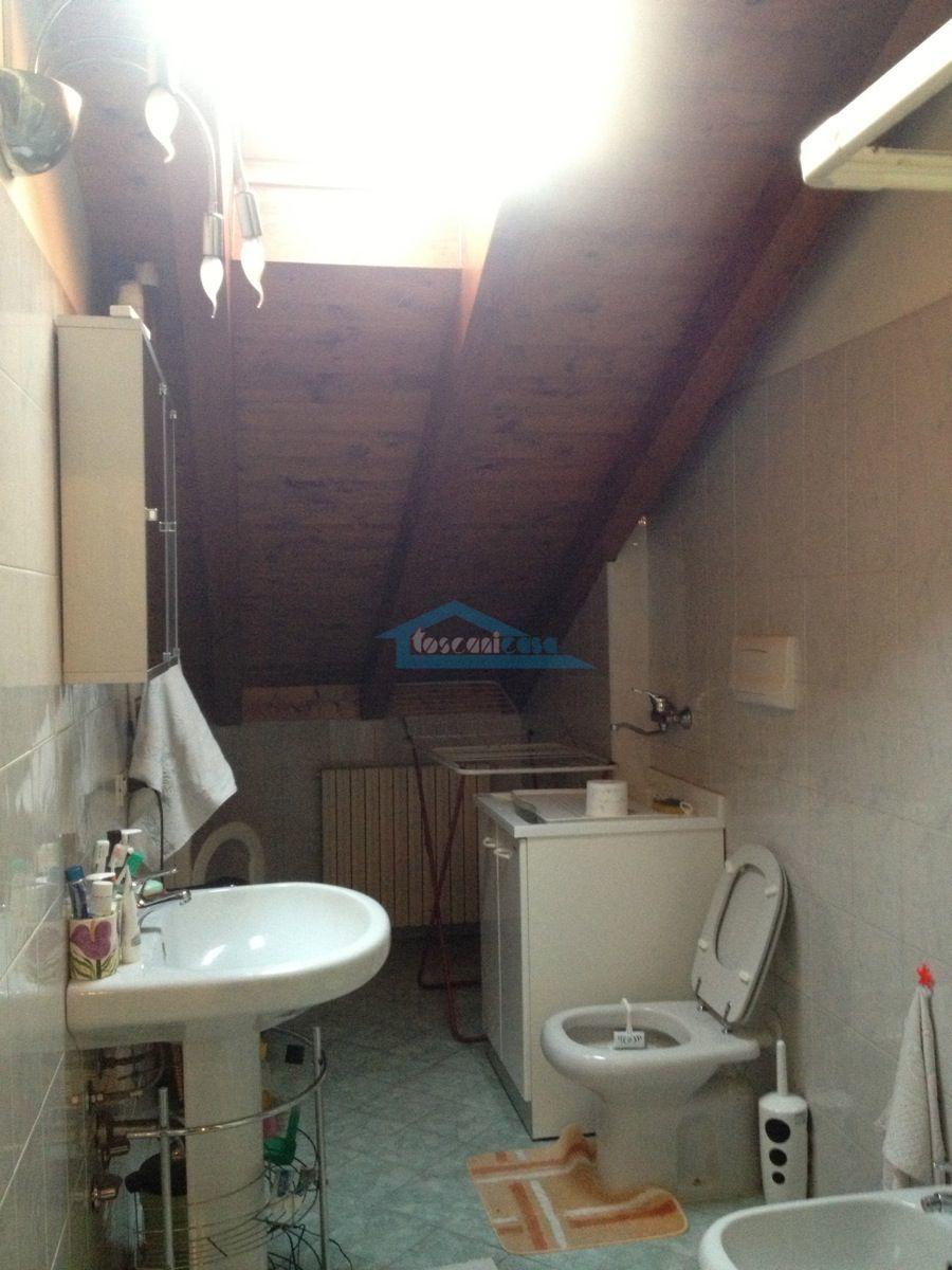 Bagno con lavanderia Appartamento  a Adro
