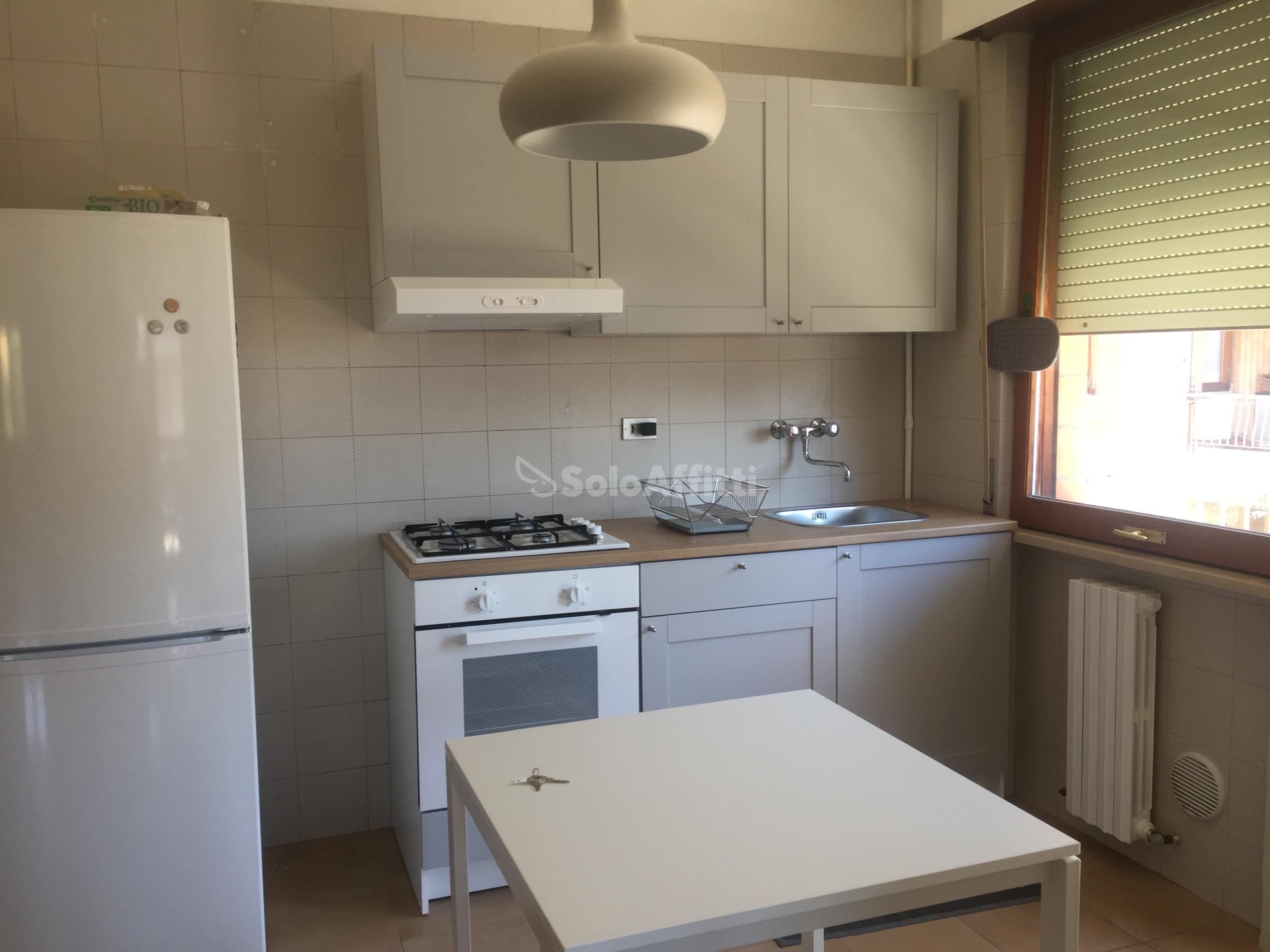 Cucina abitabile con balcone